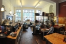 A view of the back part of Cafe 1901, looking towards the windows at the front.