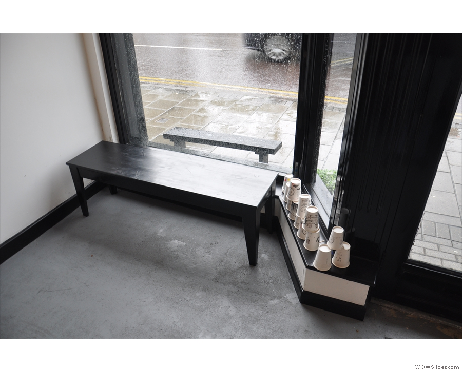 There's a choice of seating, including this bench in the window to the right of the door...