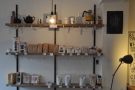 Plenty of coffee, tea and coffee/tea-making kit line the shelves behind the counter.