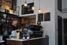 The barista, Santa, hard at work on what was her last day at Saint Espresso.