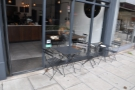 A closer look at the outside tables, with the communal table on the other side of the window.