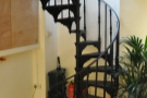 Before we head back upstairs, let's take a last look at the amazing spiral staircase.