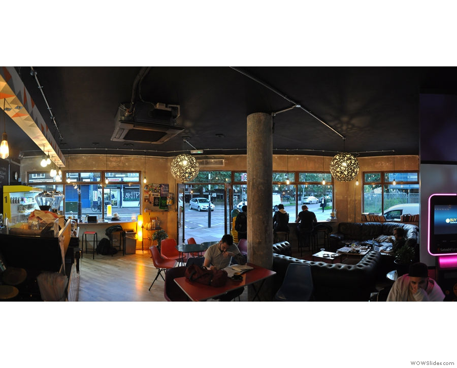 Finally, a panoramic view from the back, looking towards the windows/door at the front.