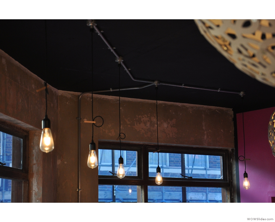 ... as well as more traditional naked light-bulbs in the windows.