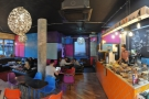 A panoramic view of Jonestown from just to the right of the door. I warned you it's colourful!