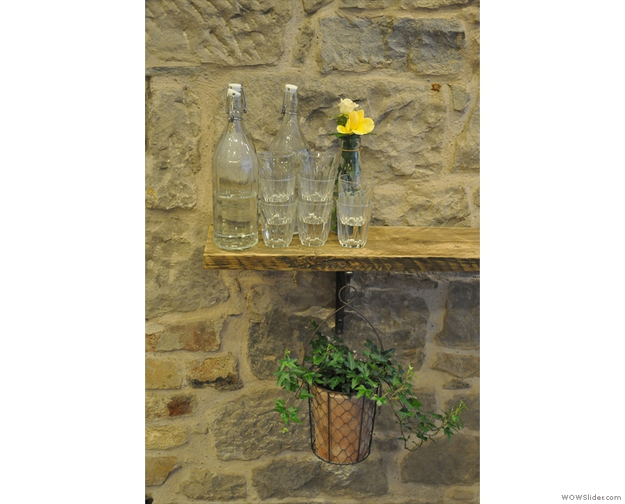 Although it's mostly stone and wood, the Milkman also has a lot of greenery and flowers.