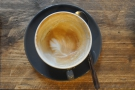 A sign that the milk's been well-steamed: the latte art is still there at the bottom of the cup.