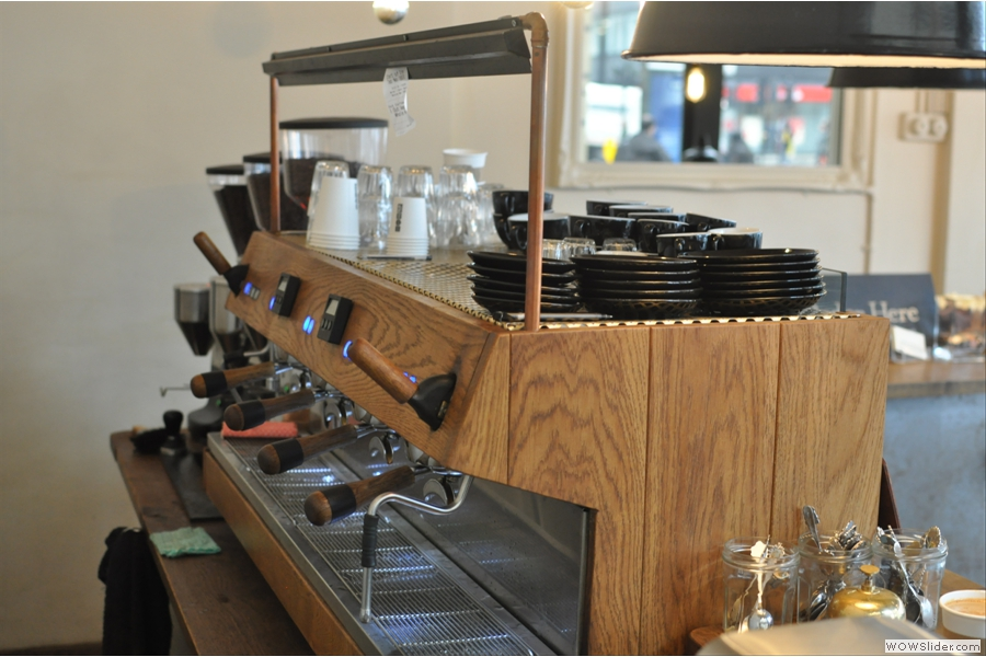 Another view of the espresso machine, tastefully clad in wood.