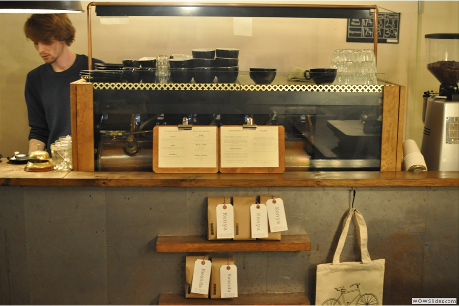 The espresso machine on my first visit, with the single-origin coffee beans for sale on the shelves below