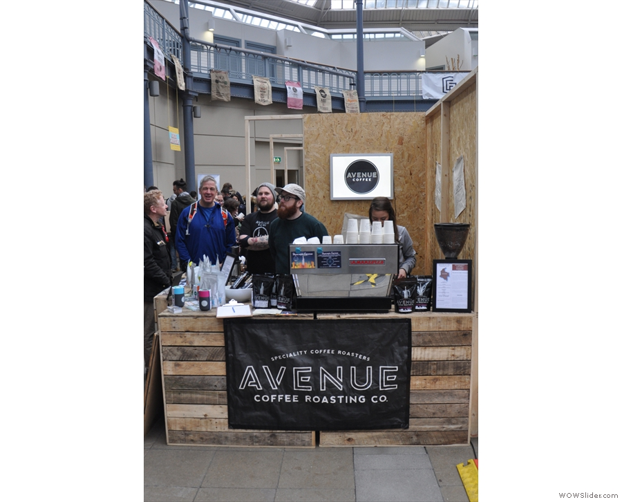 Okay. Time for my first coffee of the day. Now, who's that at the Avenue Coffee stand?