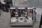 ... while the one on the right, while looking like a lever machine, works on boiler pressure.