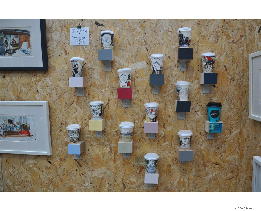 ... while on the back wall, hand-illustrated takeaway coffee cups.