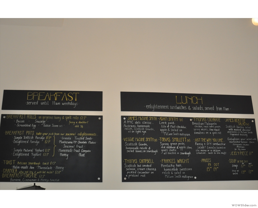 The breakfast and lunch menus are on the wall behind the counter.