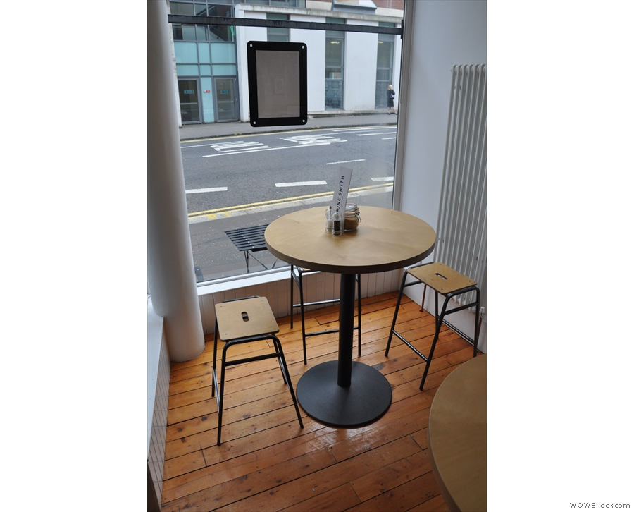 The table in the window. There's another just like it in the window to the right of the door.