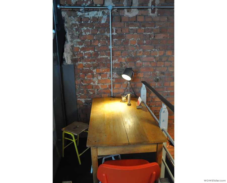 There's seating up here too, such as this table to the right. It's not technically Grindsmith's...