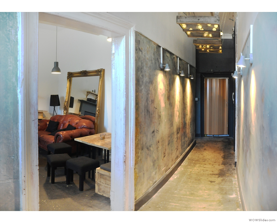... the toilet on the left, while on the right, through this doorway, is this interesting room.