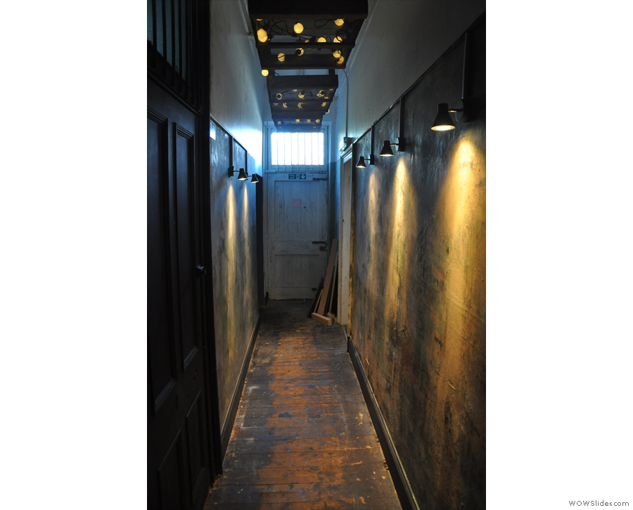 ... down this long, shall we say 'interesting' corridor. At the far end, you'll find...