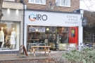 Giro Cycles, on the High Street in Esher: coffee, cycle, culture. And a bike on the roof!!