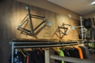 At the top of the stairs, there's this retail area, with more clothing & bike frames on the wall.
