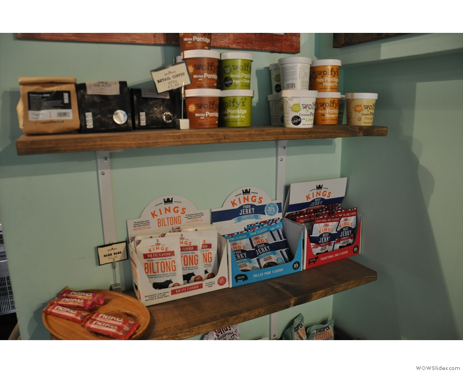 There are various bits and pieces on sale on these shelves next to the counter...