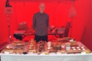A proud owner and his slightly blurry cakes at the S'mores tent.