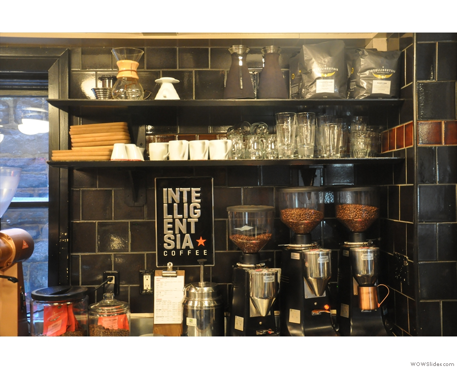 On the back wall, the grinders and filter equipment.