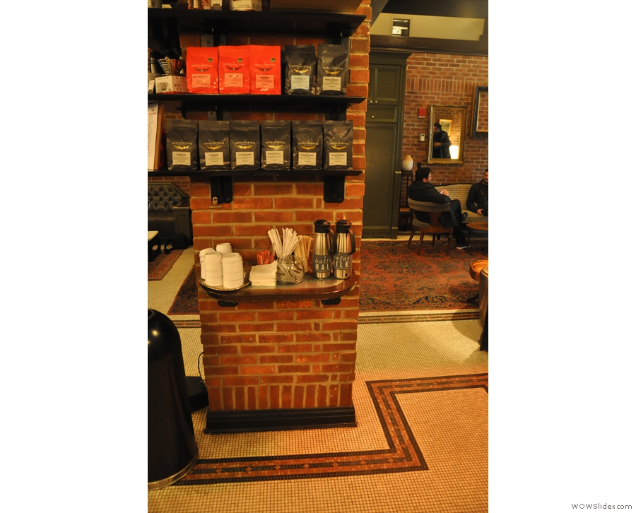 Moving on, the brick pillar at the entrance to the counter doubles as merchandising shelves.