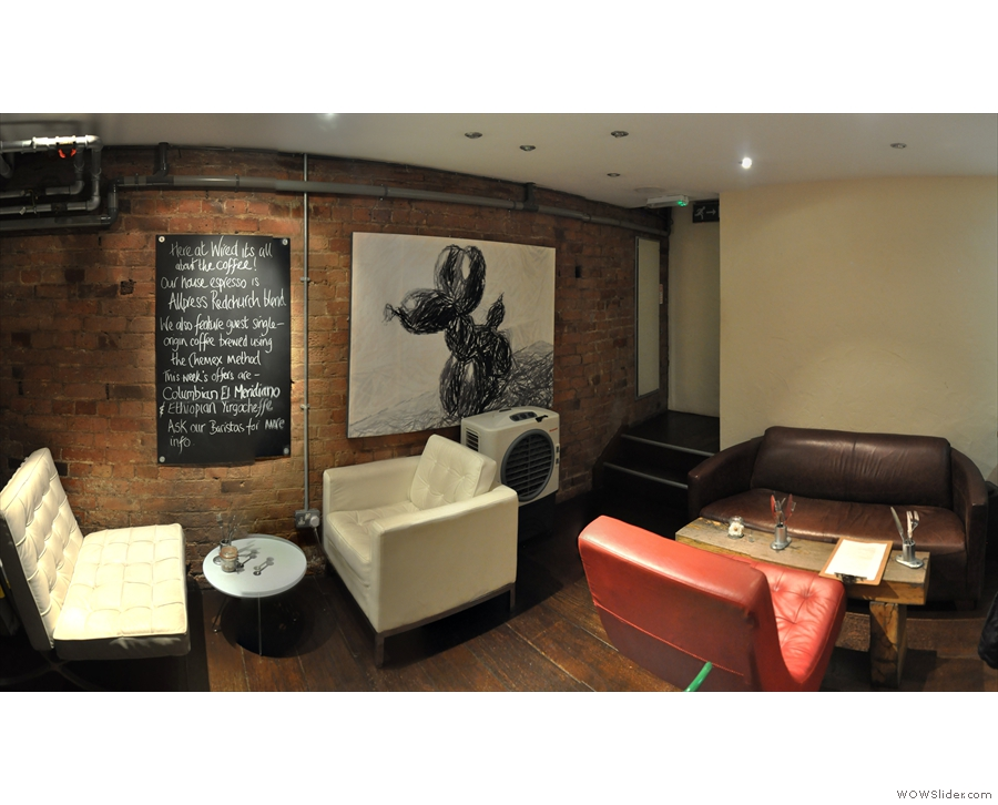 A panoramic view from the opposite corner. It's a very different choice of seating down here!