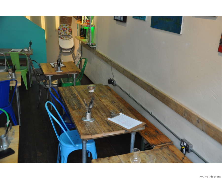 I really liked these four-person tables up against the wall.