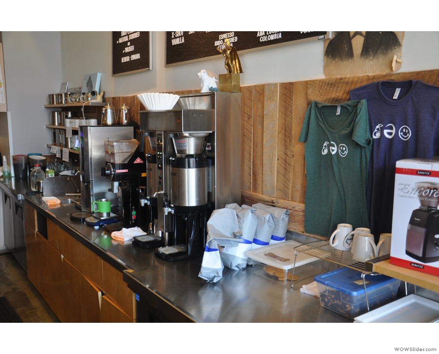 The filter station is behind the espresso machine, complete with boiler and grinders.