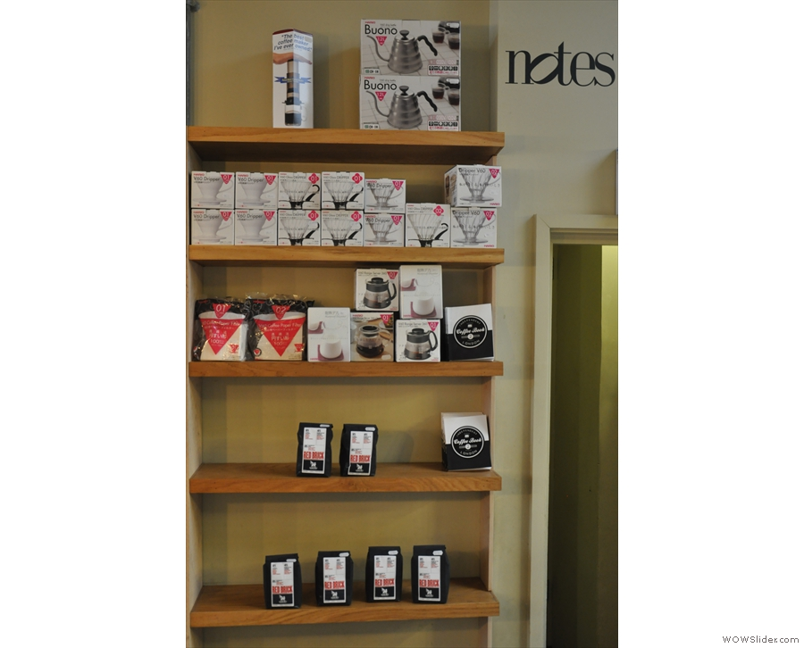 Shelves of coffee and coffee-making kit