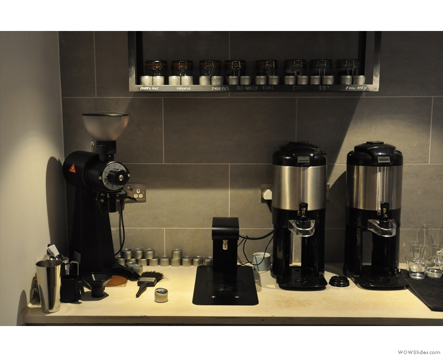 The EK-43 (for the filter), hot water and bulk-brewers are behind the espresso machine.
