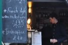 Elements of the menu are chalked up along the side of the counter...