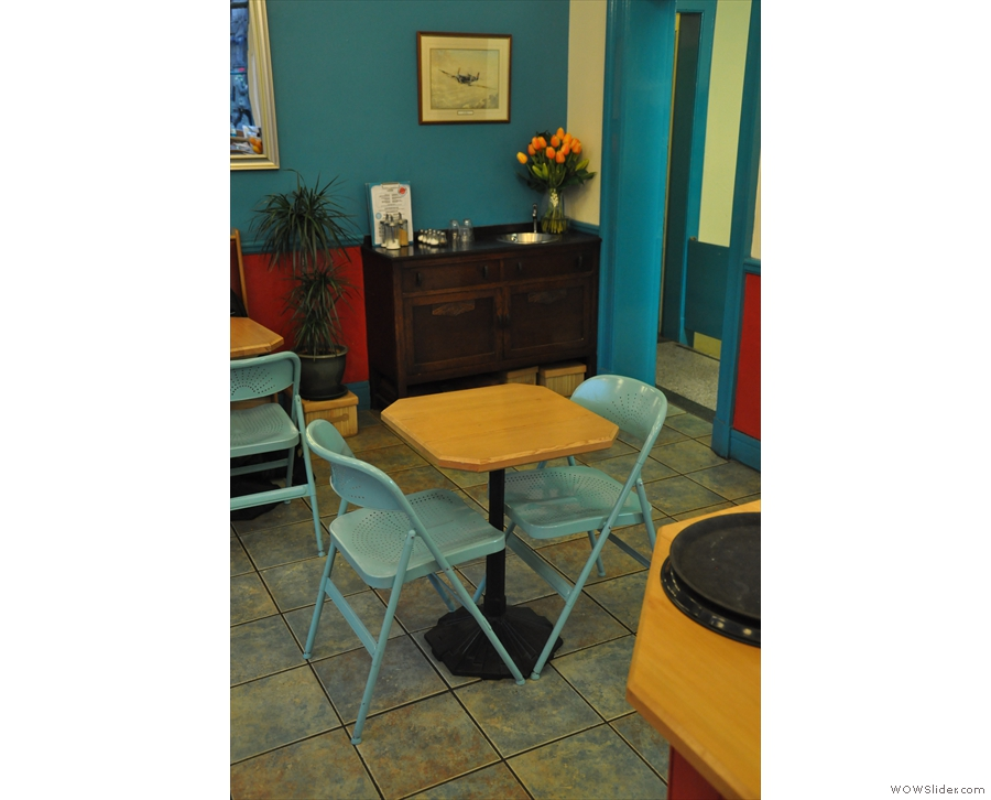 ... and this solitary table beyond the counter.