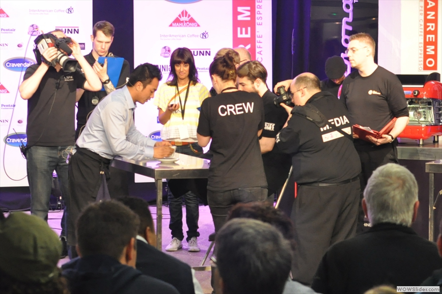Dhan presents the latte to the judges. The time-keeper (each contestant has six miuntes) looks impressed!