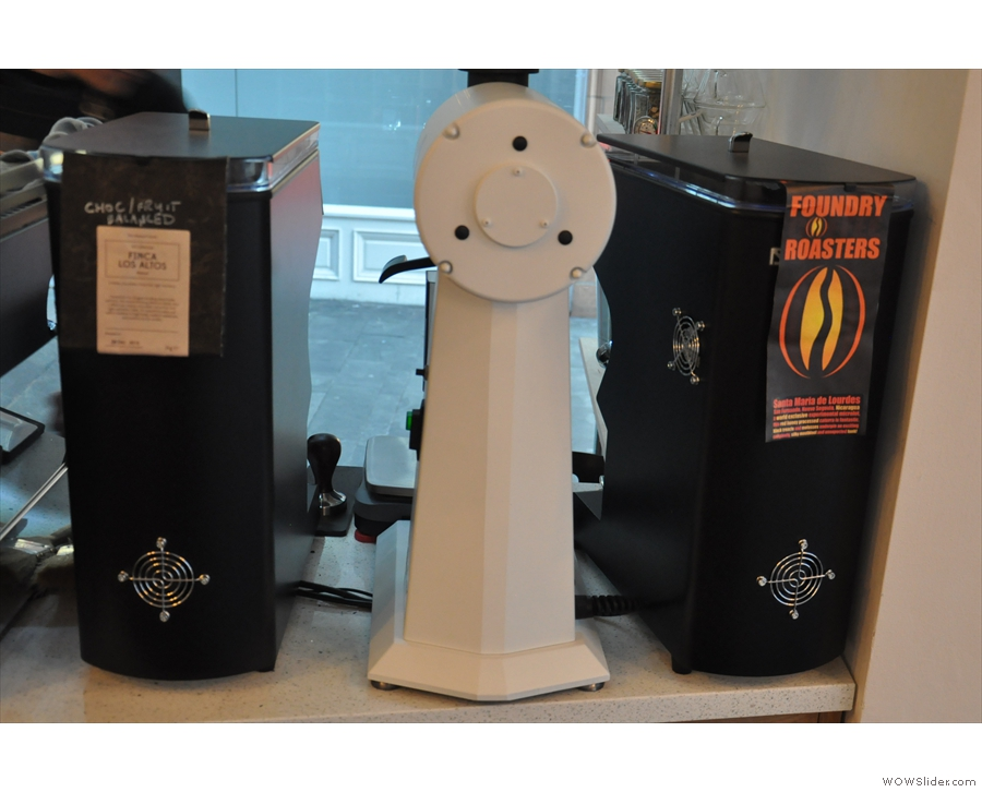 The espresso grinders are Mythos Ones, one for the house roaster and one for the guest.