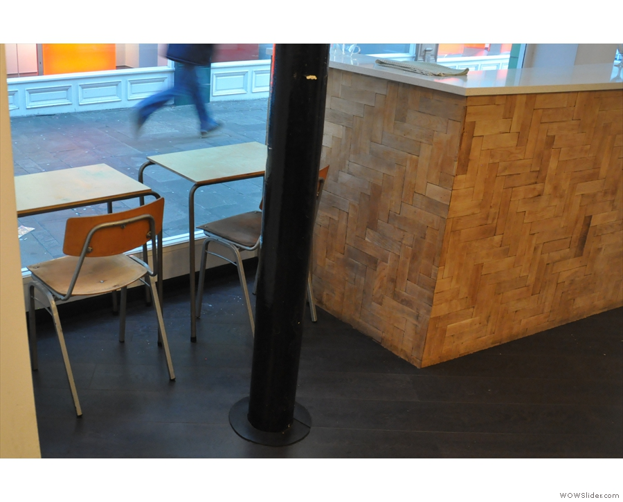 ... with a couple of tables tucked in between the doors and the counter...