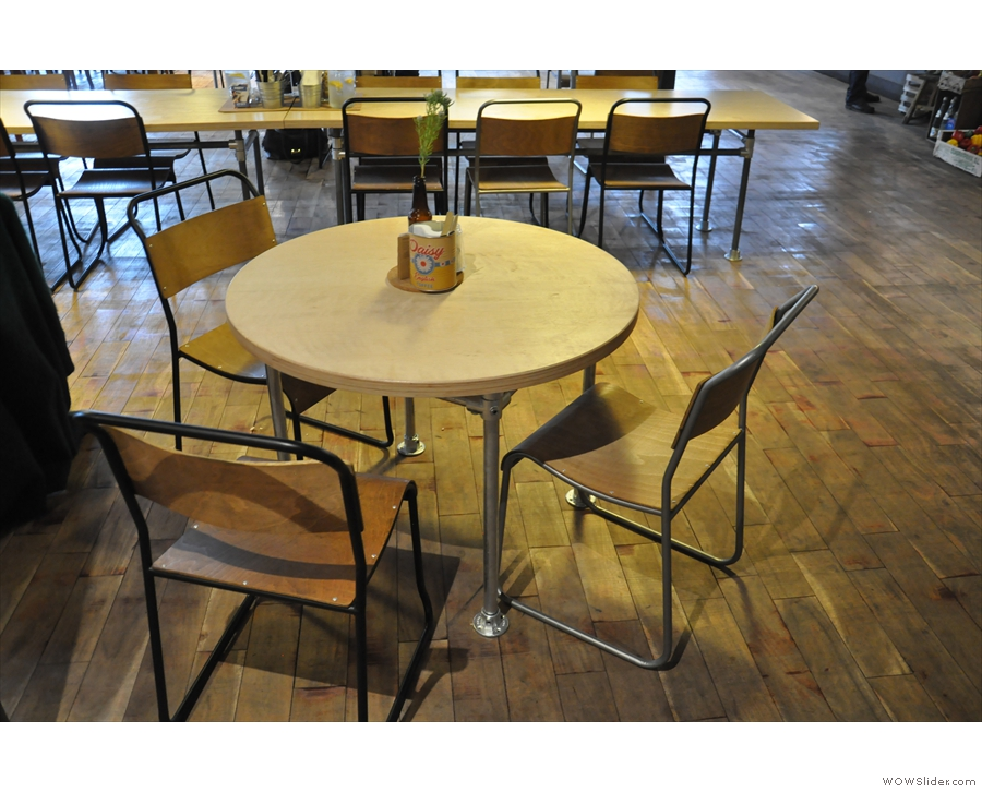The seating's an interesting mix. Near the door, there are round tables like this one...
