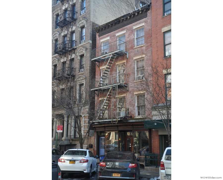 Cafe Grumpy on New York's tree-lined W 20th St, in a lovely, four-storey brick building.
