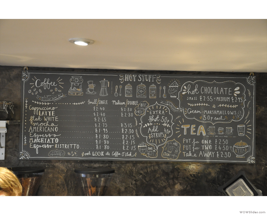 The hot drinks menu is above the counter...