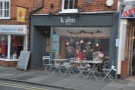 The Kalm Kitchen Cafe on Guildford's Tunsgate, now with tables outside on the pavement.
