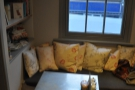 My favourite has always been this bench/table in the corner, with all the cushions...
