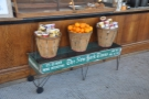 ... and beneath them, some oranges, flanked by pots of oatmeal. Nice trolley by the way.
