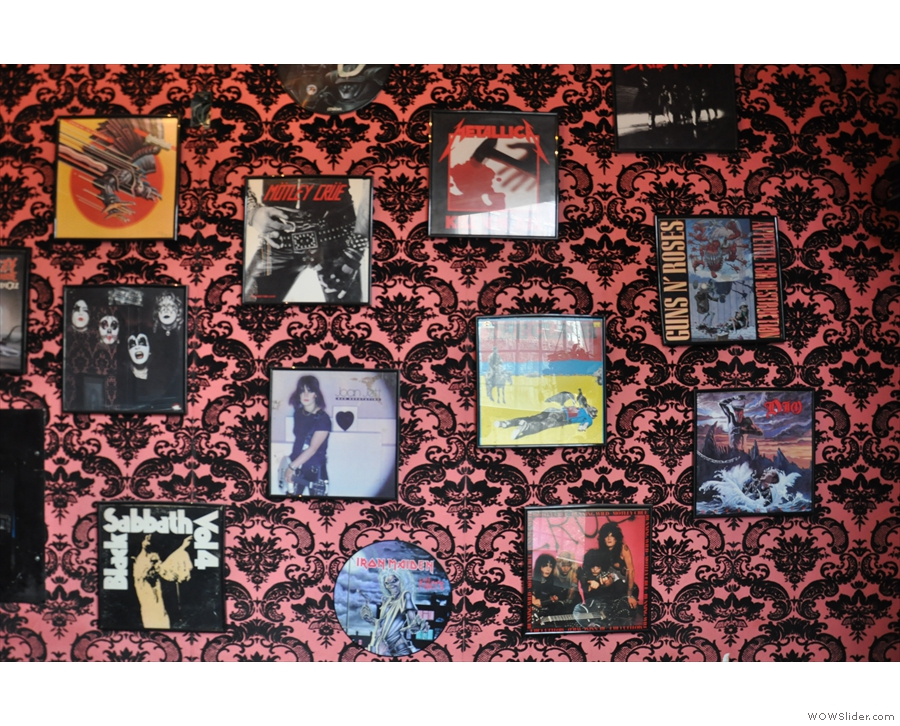 The walls are decorated wth old LP covers, with a heavy emphasis on heavy metal.