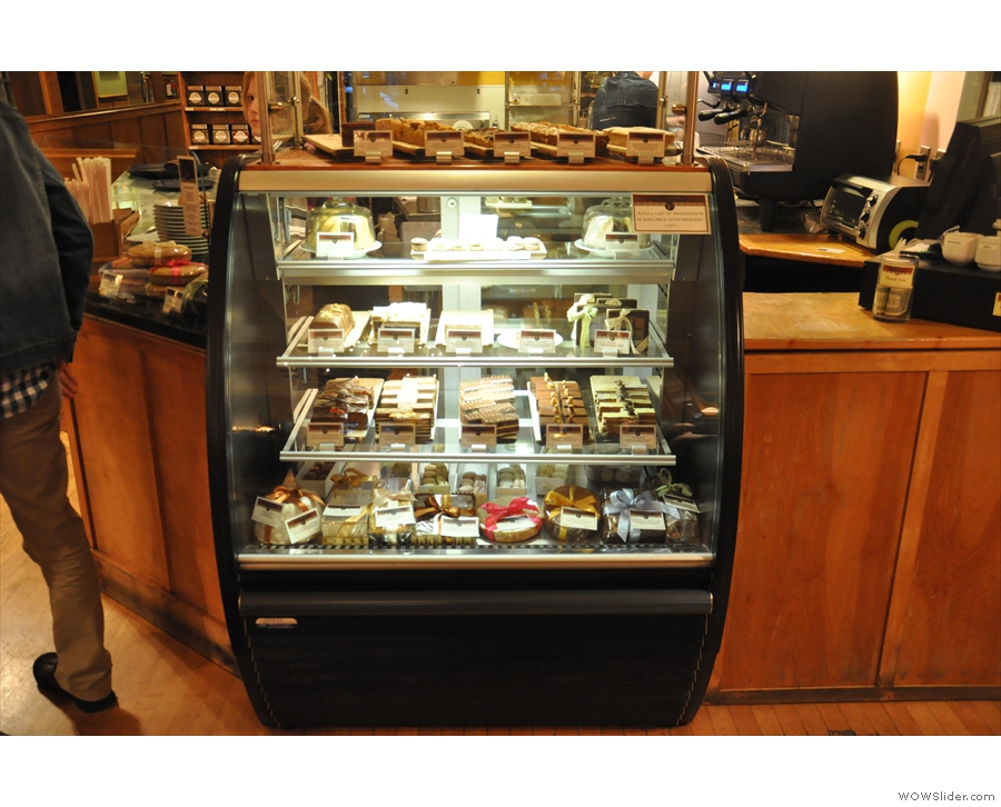 Overkill: there is a cabinet full of cakes next to the till.