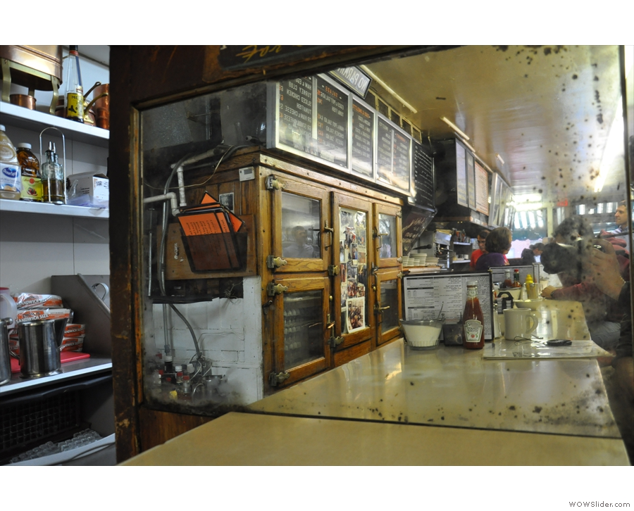 More changes: there used to be a large mirror on the back wall at the end of the counter.