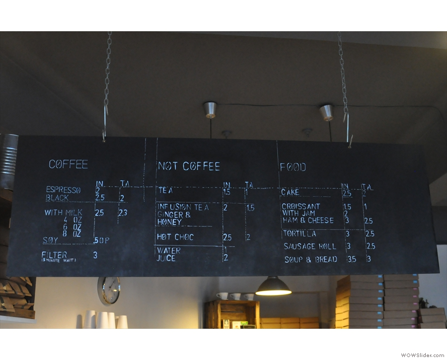 The menu hangs from the ceiling above the counter, just as it did back in 2012...