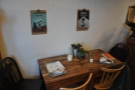 ... while the other major seating is at this little table against the wall to the left.