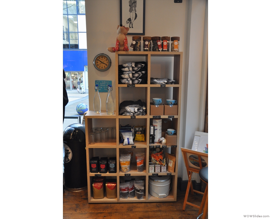 There's also a large set of retail shelves, with coffee and merchandising...