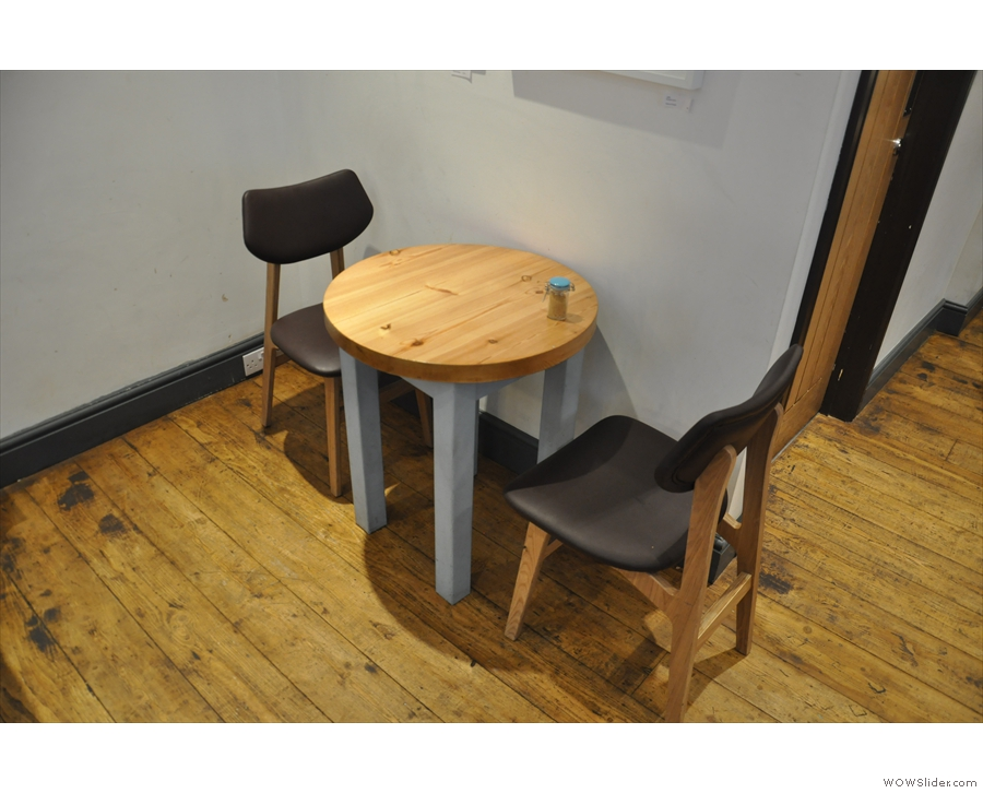 ... while this cosy little table for two is at the back.